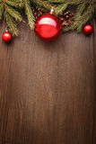 Christmas Tree and decorations on wooden background Stock Photo