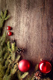 Christmas Tree and decorations on wooden background Royalty Free Stock Images