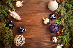 Christmas Tree and decorations on wooden background Stock Image