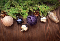 Christmas Tree and decorations on wooden background Royalty Free Stock Photo