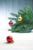 Christmas Tree and decorations on wooden background Stock Images