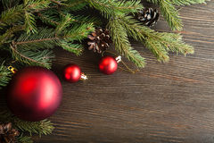 Christmas Tree and decorations on wooden background Royalty Free Stock Photography