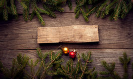 Christmas Tree and decorations on wooden background Royalty Free Stock Image