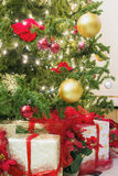 Christmas Tree with Decorations and Wrapped Gifts Stock Photography