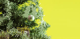 Christmas tree with decorations on yellow background Stock Image