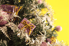 Christmas tree with decorations on yellow background Royalty Free Stock Photography