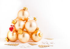 Christmas Tree from decorative gold glass balls. Horisontal image  Gold Holiday decorative tree balls stocked on each other creating christmas tree Stock Image