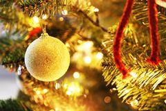 Christmas tree with decorative ornaments, balls and golden lights. Bokeh lights background Stock Photos