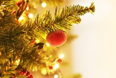 Christmas tree with decorative ornaments, balls and golden lights. Bokeh lights background Stock Images