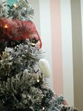 Christmas tree decotared with white sparkling heart and lights. stock image