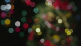 Christmas tree defocus to beautiful bokeh. On black background stock video