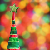 Christmas tree on defocused lights background Royalty Free Stock Images