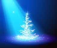 Christmas tree with defocused lights. blue background Royalty Free Stock Photography
