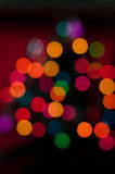 Christmas tree with defocused lights. Red background Stock Photo