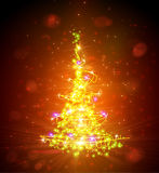 Christmas tree with defocused lights. Red background Royalty Free Stock Image
