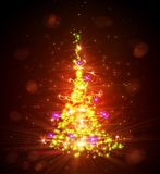 Christmas tree with defocused lights. Red Royalty Free Stock Photography