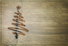 Christmas tree design brushed onto rustic wood background. Christmas tree design creating a rustic, country Christmas impression Royalty Free Stock Images