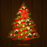 Christmas tree design. Green Christmas tree decorated of red ribbons and golden balls on the wooden background Royalty Free Stock Photos