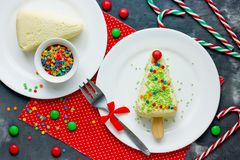 Christmas tree dessert - cheesecake with colorful sugar sprinkles royalty free stock photography