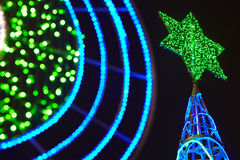 Christmas tree detail with green and blue lights decoration. Out Royalty Free Stock Photography