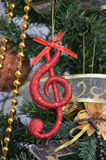 Christmas tree ,details, musical notes, balls Royalty Free Stock Photo