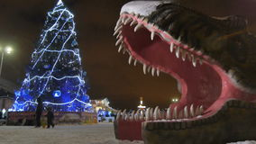 Christmas tree dinosaur sculpture mouth in entertainment park stock video footage