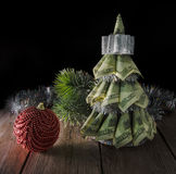 Christmas tree by dollars Stock Photography