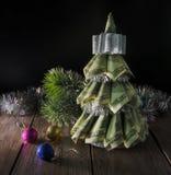 Christmas tree by dollars Royalty Free Stock Photo
