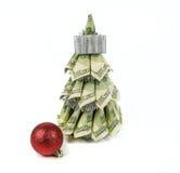 Christmas tree by dollars Royalty Free Stock Photos