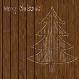 Christmas tree drawing chalk on a background of wooden planks. royalty free illustration