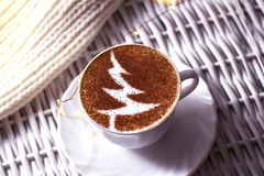 Christmas tree ,drawing coffee cup. Christmas tree ,drawing on latte art coffee cup stock photography