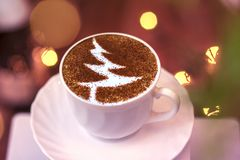Christmas tree ,drawing coffee cup. Christmas tree ,drawing on latte art coffee cup royalty free stock photo