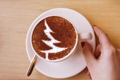 Christmas tree ,drawing coffee cup. Christmas tree ,drawing on latte art coffee cup royalty free stock photos