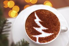 Christmas tree ,drawing coffee cup. Christmas tree ,drawing on latte art coffee cup royalty free stock photography