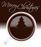 Christmas tree drawing on coffee surface. Christmas tree in snowfall - drawing on coffee surface in white cup greeting card Stock Photos