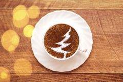 Christmas tree ,drawing coffee cup. Christmas tree ,drawing on latte art coffee cup stock images