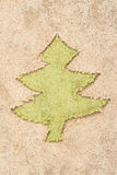 Christmas tree drawing in sand stock photos