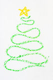 Christmas tree drawn in crayon. Christmas tree drawn with a curved green crayon line and a yellow star Stock Photo