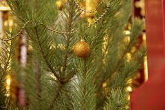 Christmas tree dressed for the Nativity in the Orthodox Church. Fragment with a sparkling golden ball close-up Stock Photos