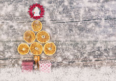 Christmas Tree From Dried Oranges, Cinnamon Sticks And Red Star. Stock Photo