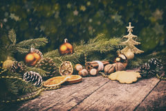 Christmas Tree, Dried Oranges, Cookies, Walnuts, Hazelnut, Cones, Baubles, Cinnamon. Royalty Free Stock Images