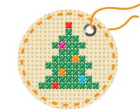 Christmas tree embroidered on a piece of tissue. Stock Photography