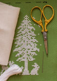 Christmas tree. Embroidered with scissors, needle Stock Images