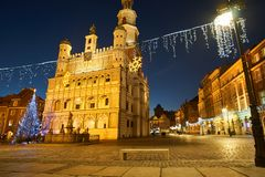 Christmas tree and facade of the Renaissance town hall building stock photography