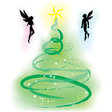 Christmas Tree with Fairy. Beautiful Christmas tree with two fairy beside the tree Stock Photos