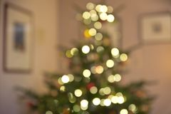 Defocused Christmas tree fairy lights. Christmas tree with fairy lights in a room defocused, abstract bokeh lights Royalty Free Stock Photography
