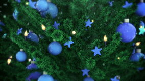 Christmas tree with falling snow. Decorated Christmas Tree with balls, stars and light bulbs, falling snow stock video footage