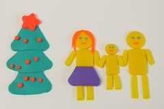 Christmas tree and family mother, father, kid figures from mo stock photos