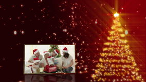 Christmas tree and familys animation Royalty Free Stock Images