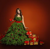 Christmas Tree Fashion Woman Dress, Model Girl, Red Presents. Christmas Tree Fashion Woman Dress, Model Presents Gift Boxes, Girl on Red Background, New Year